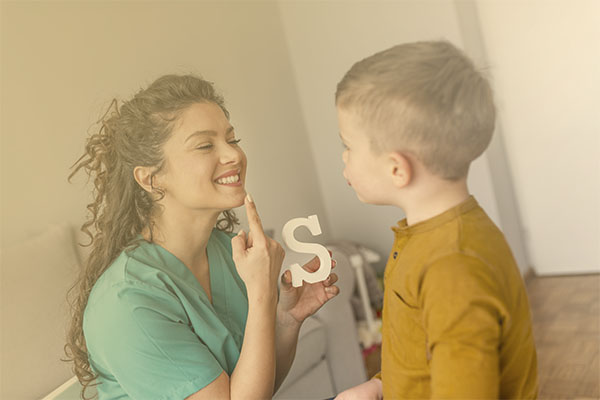 speech therapist working with young child