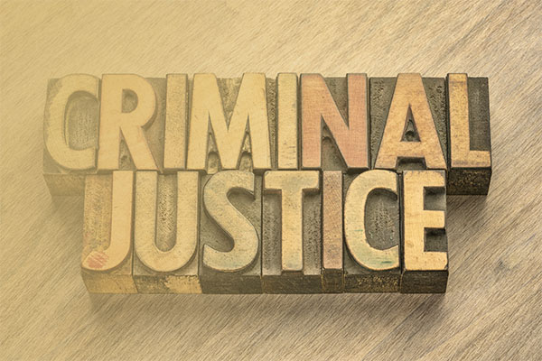"printing block letters spelling out ""criminal justice"""